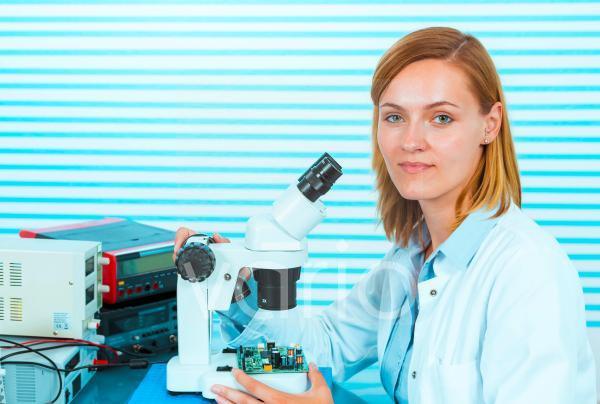 Technician with microscope, portrait