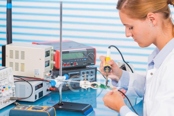 Technician working on circuit board