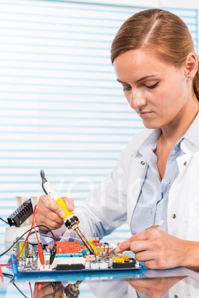 Technician working on a circuit board