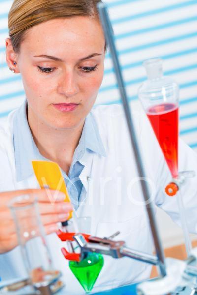 Female chemist working in lab