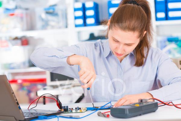 Female electrical engineer testing