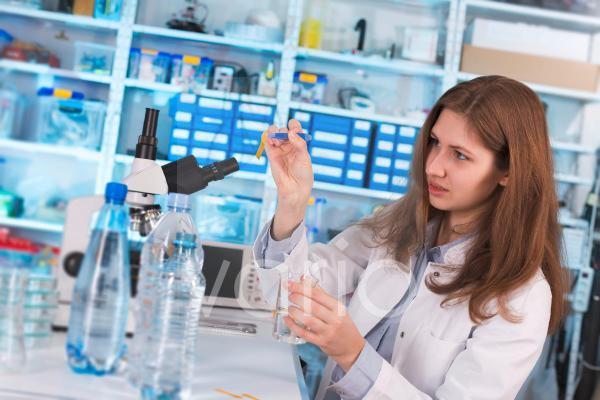 Lab technician testing water in lab