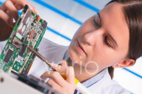 Female electrical engineer with circuit