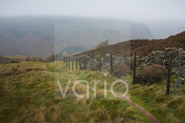 A misty autumnal view from Lingmoor Fell to Wrynose Fell in the English Lake District National Park.
