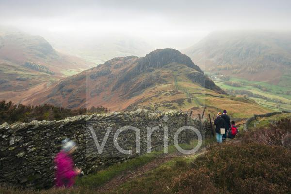 Side Pike from Lingmoor Fell with Wrynose Fell and  Bow Fell and Langdale Fell in the mist in the English Lake District National Park.