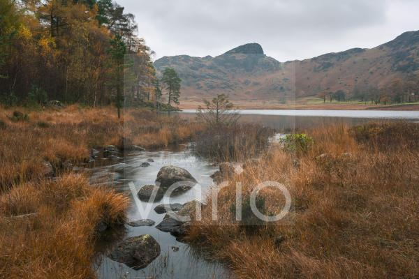 Bleamoss Beck and Blea Tarn with Side Pike beyond in the English Lake District National Park.