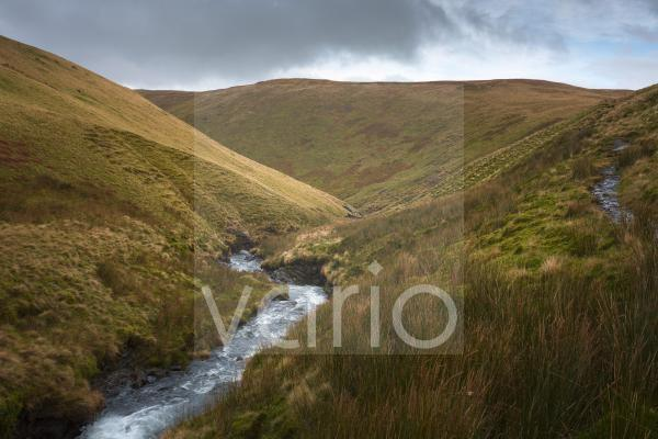 River Glenderamackin in the valley between Bannderdale Crags and Scales Fell with Southern Fell beyond in the English Lake District National Park.