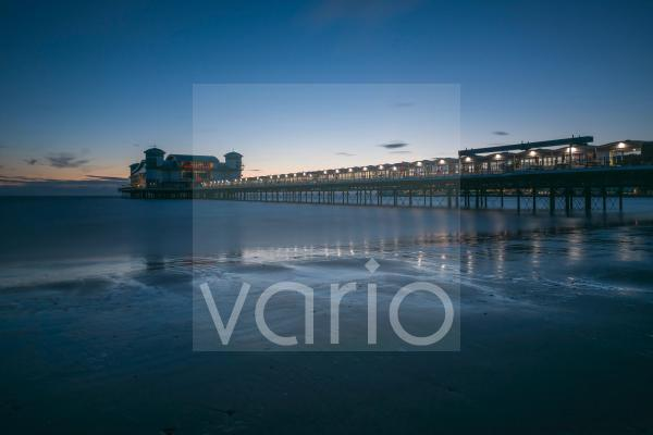 The Grand Pier at dusk at the English seaside town of Weston-super-Mare.