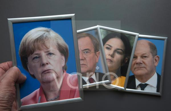 Illustrtaion photo on the subject of the 2021 federal election. Framed portrait photos of Angela Merkel, Armin Laschet, Annalena Baerbock and Olaf Scholz.
