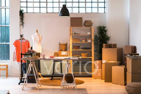 Fashion design studio with delivery boxes