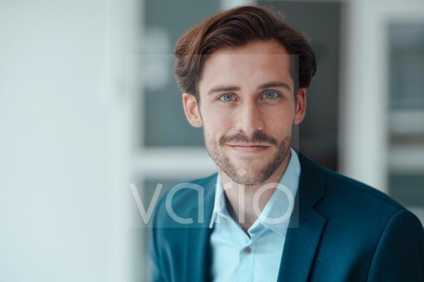 Smiling male professional in office