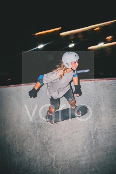 Man with sports helmet skateboarding at park