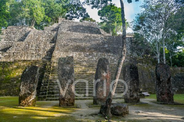 Mexico, Campeche, Menhirs standing in front of ancient Maya temple in Calakmul