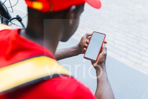 Delivery man using mobile phone
