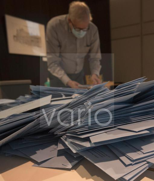 Bundestag election 2021. Sorting and arranging the postal voting papers in Bonn.
