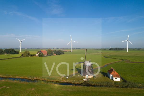Nederland, Tjerkwerd, Aerial view of windmill, house and turbines