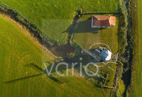 Nederland, Tjerkwerd, Overhead view of windmill and house in field