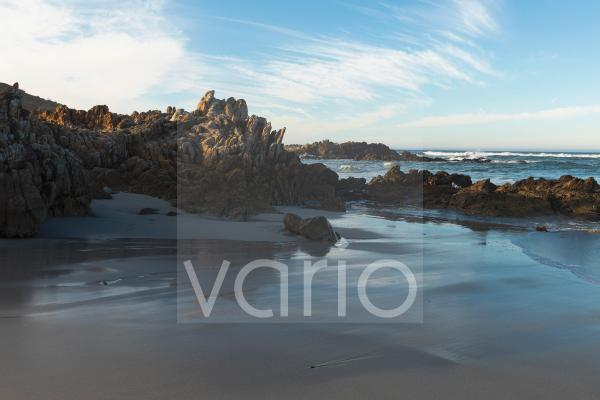 A deserted beach, jagged rocks and rockpools on the Atlantic coast.