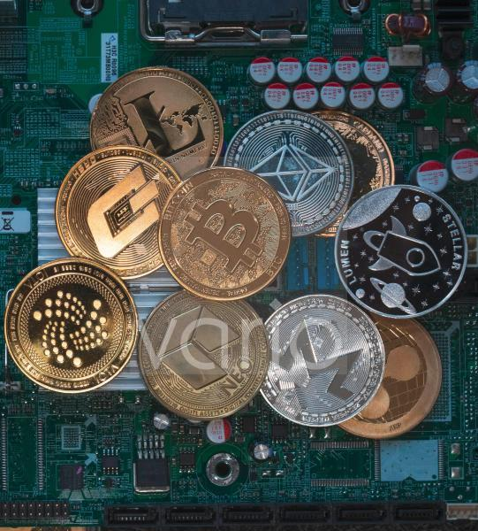 Different crypto currencies on a computer board.